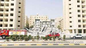 cars-wrecked-in-building-collapse_kuwait