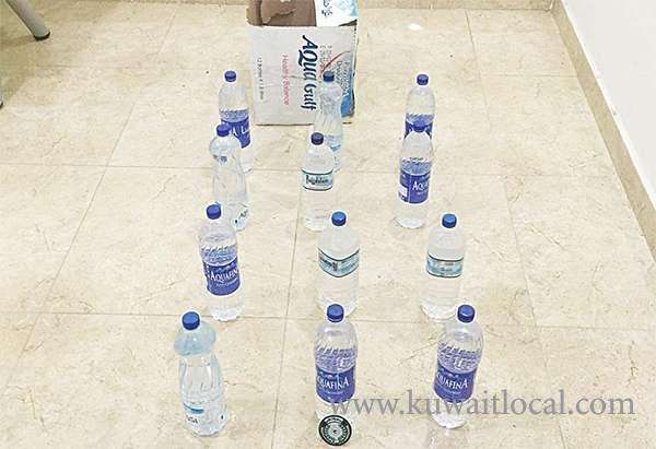 expat-arrested-for-possessing-12-liquor-bottles_kuwait