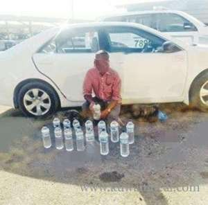 driver-arrested-with-14-liquor-bottles_kuwait