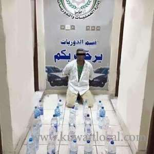 man-arrested-with-25-liquor-bottles_kuwait