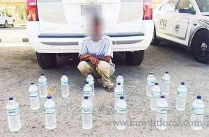 indian-arrested-for-possessing-19-bottles-of-locally-manufactured-booze_kuwait