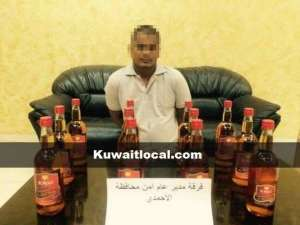 indian-arrested-with-12-imported-liquor-bottles_kuwait