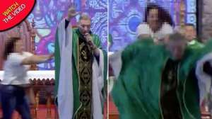 priest-pushed-off-stage-by-woman-in-front-of-thousands-of-stunned-worshippers_G2D